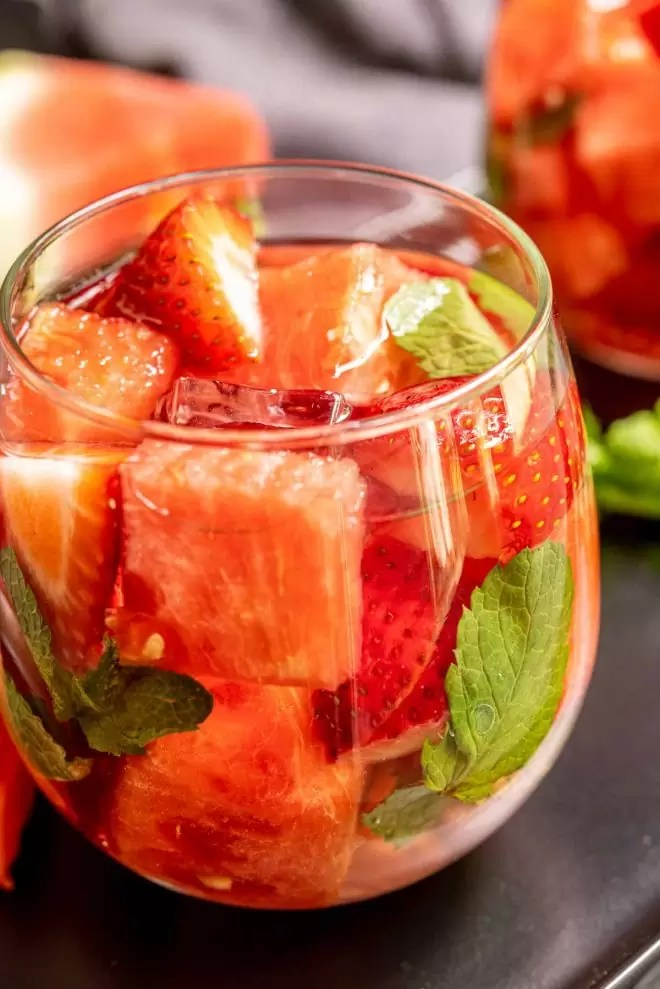 Strawberry Watermelon Infused Water in a glass with mint
