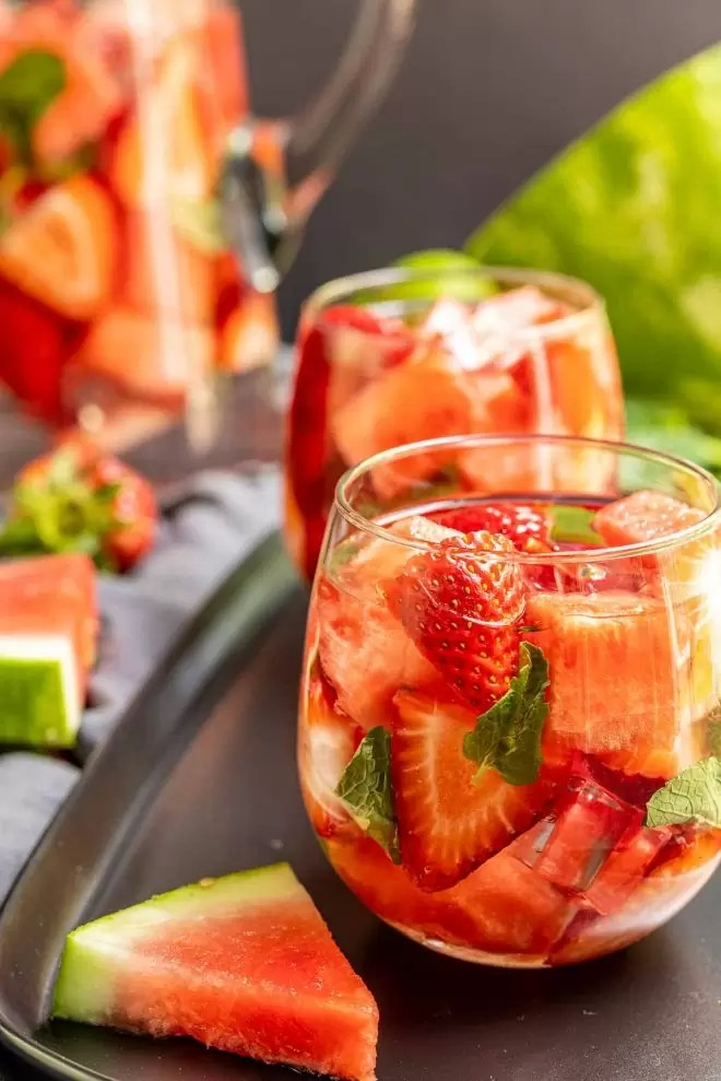 Strawberry Watermelon Infused Water in a glass made with fresh watermelon