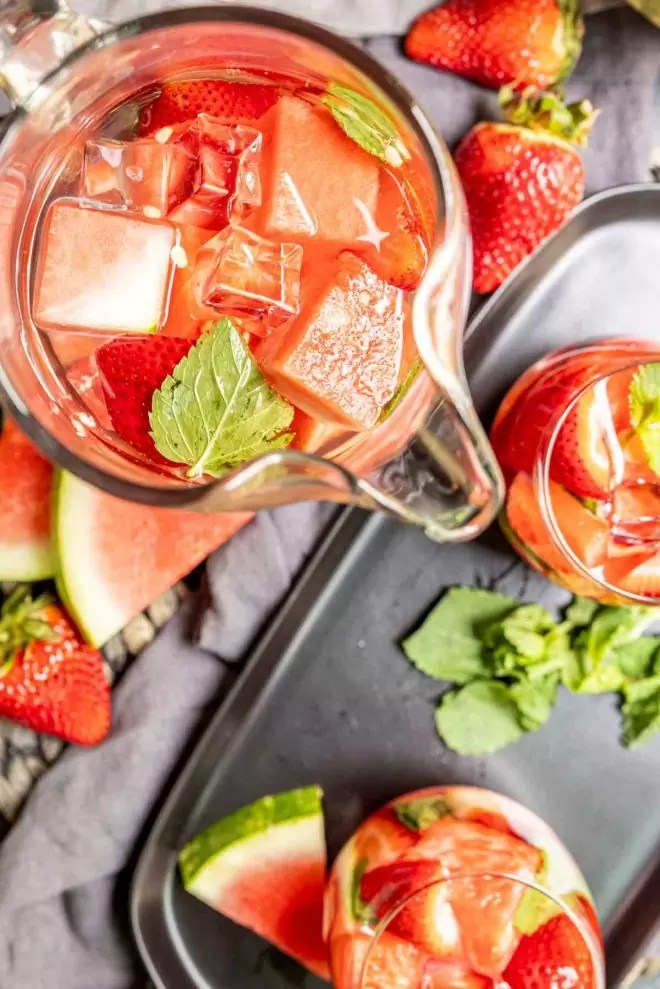 Strawberry Watermelon Infused Water in a pitch with mint
