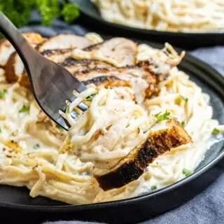 Keto Cajun Chicken Alfredo Pasta on a black fork