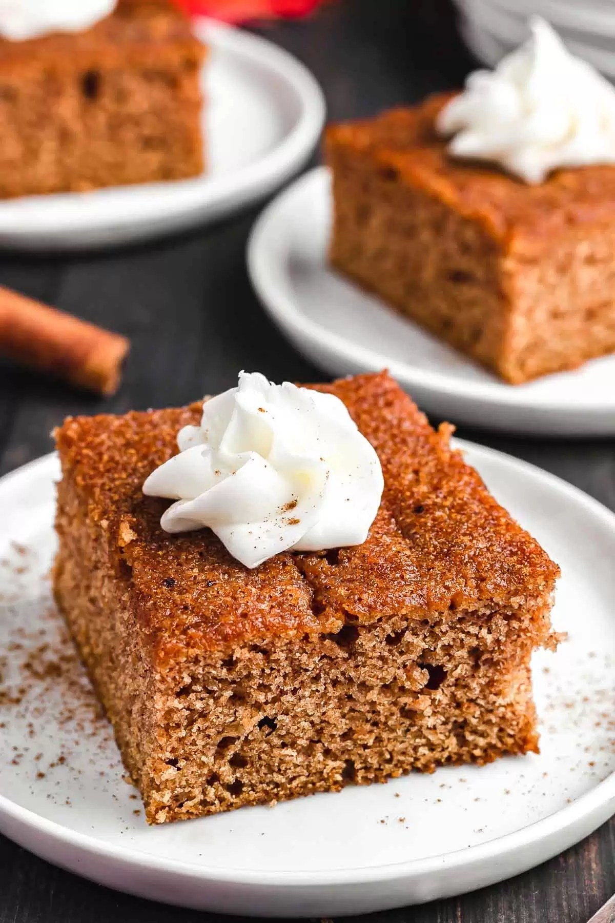Apple Spice Cake on a plate with whipped cream