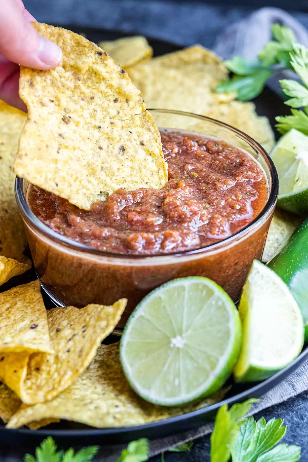 dipping a tortill a chip in Restaurant Style Salsa