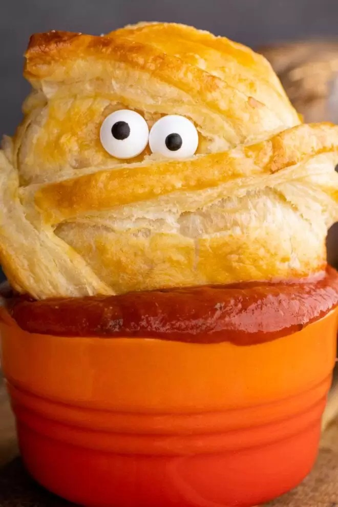 Halloween Baked Cheese mummy dunked in sauce