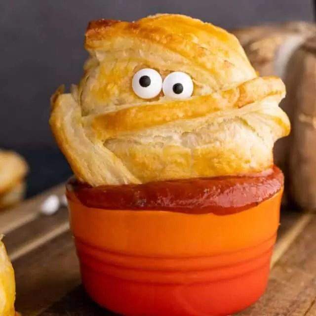 Halloween Baked Cheese mummy in sauce