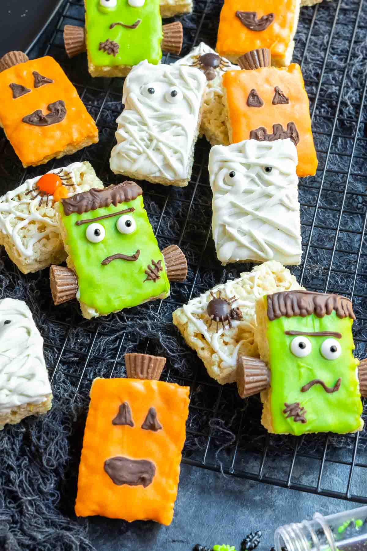 Decorated Halloween Rice Krispies Treats on a black cooling rack