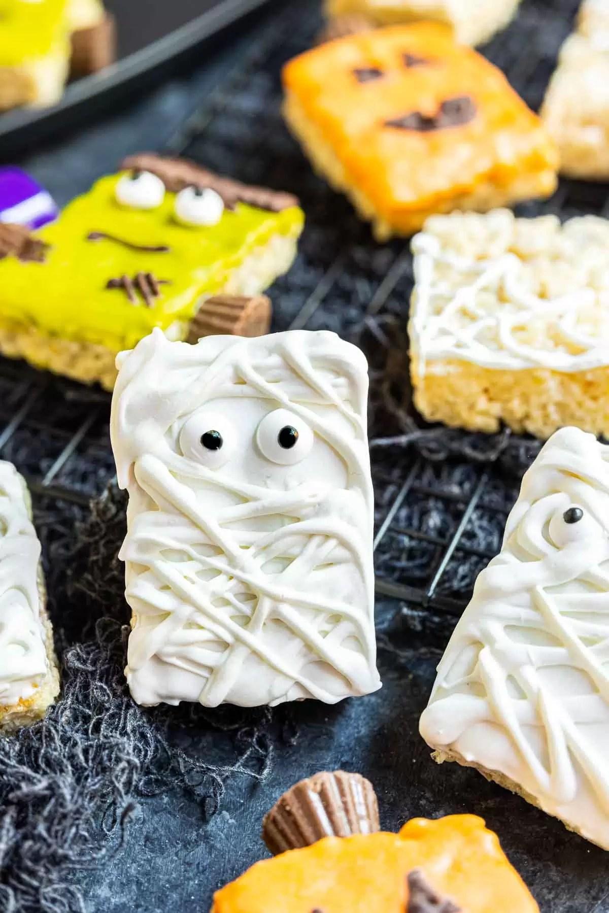 Mummy Rice Krispies Treats decorated with colored candy melts