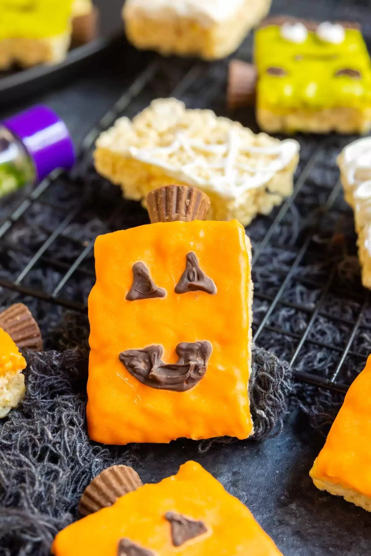 Pumpkin Rice Krispies Treats decorated with colored candy melts