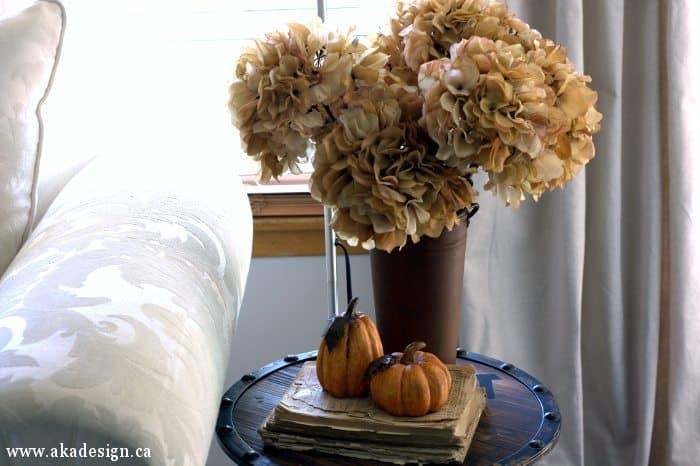 dried hydrangeas and mini pumpkins side table 1