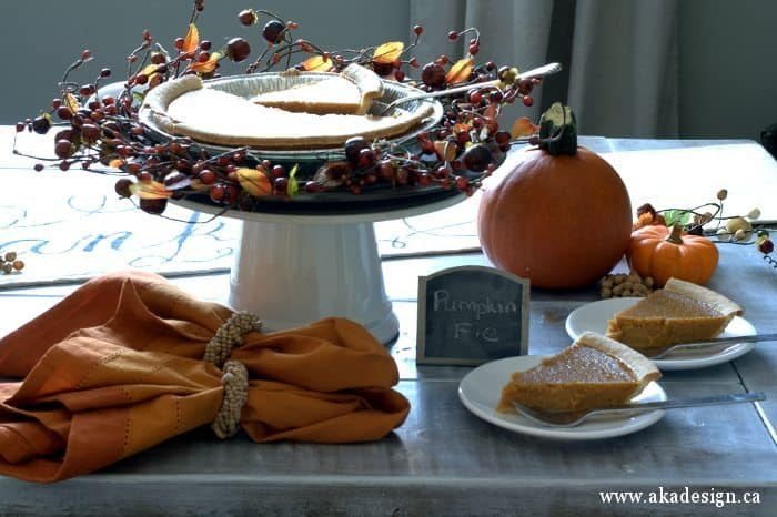 pumpkin pie on cake stand 1