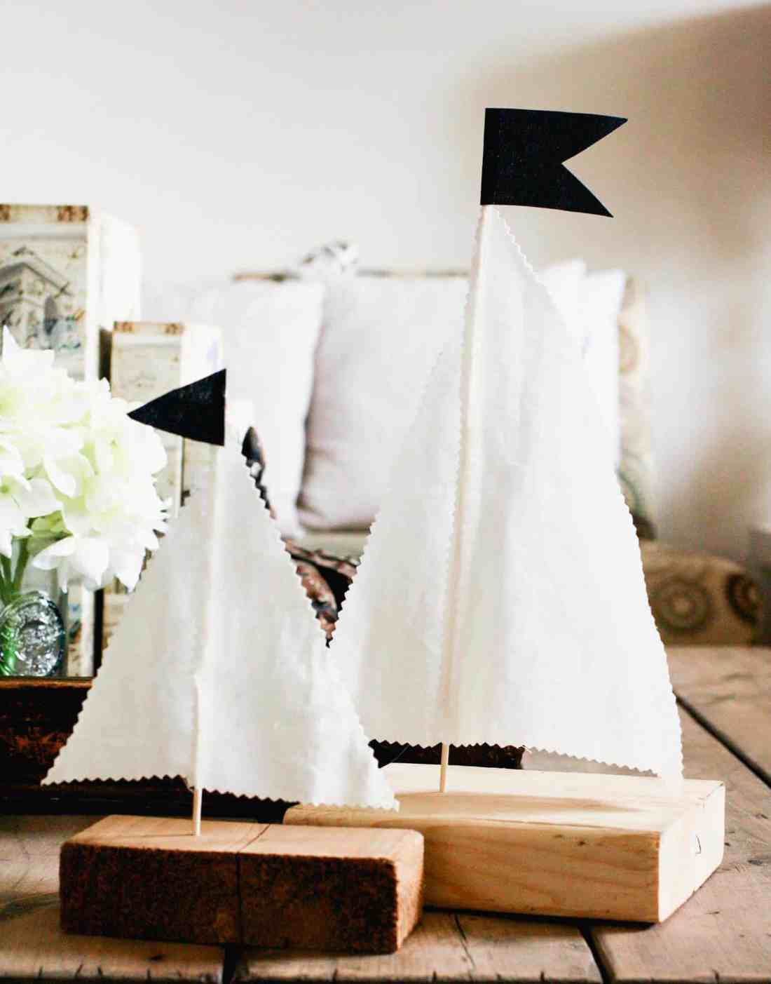 DIY wood sailboats as decor on coffee table