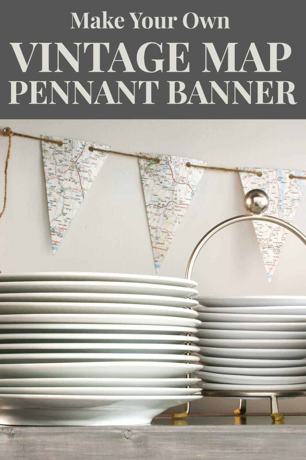 map banner pinned to wall behind stacked white dishes on a shelf