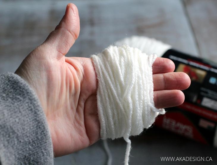 pom pom garland wrap around hand