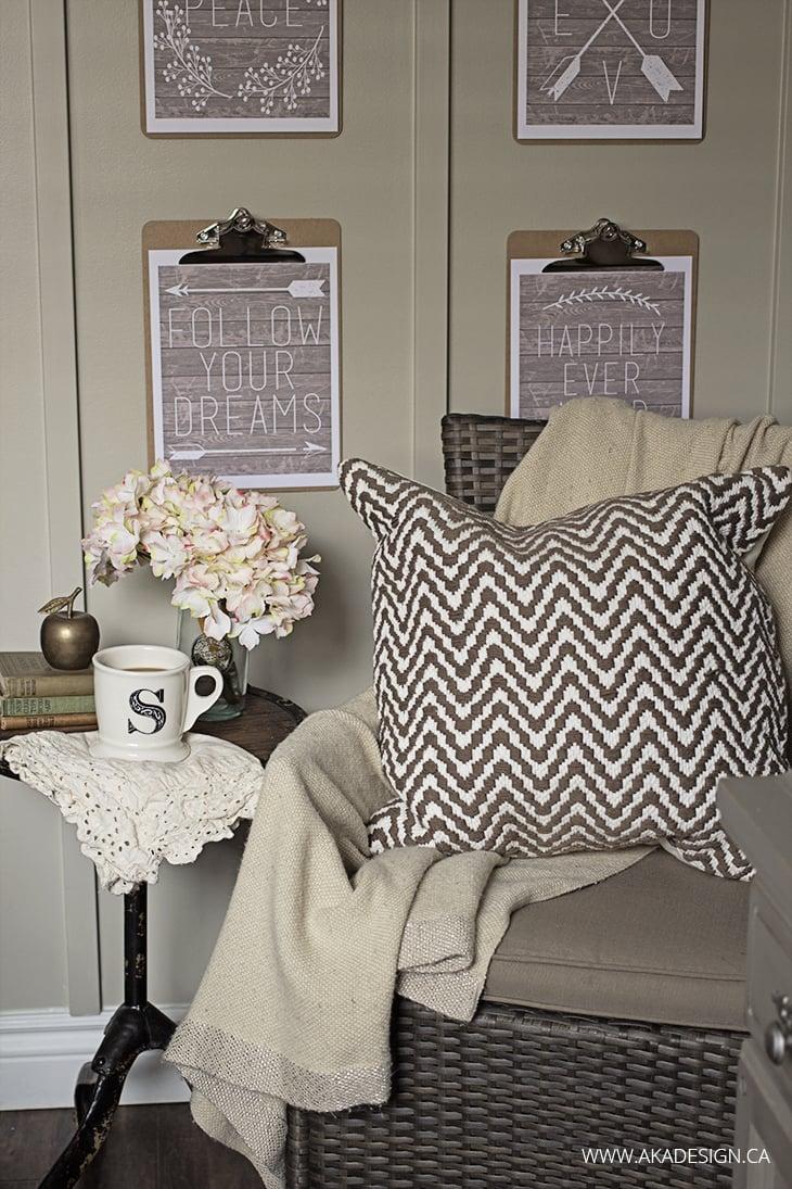 wicker chair, zigzag pillow, clipboard art, monogram mug flowers, old books