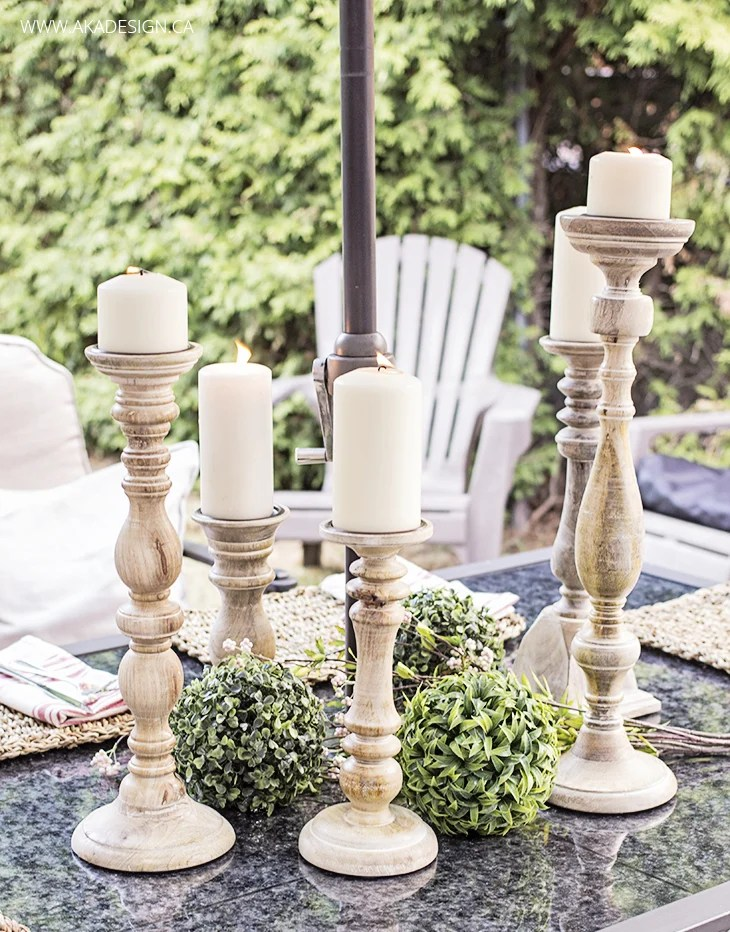 pillar candle sticks on outdoor patio