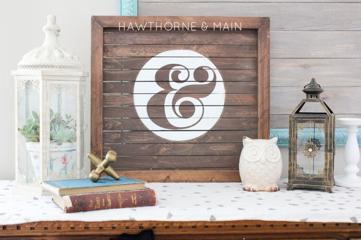 wood slat sign with ampersand painted on it 10