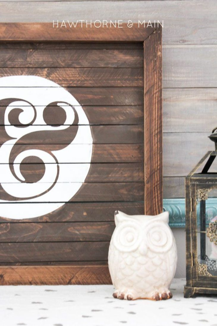 wood slat sign with ampersand painted on it 14