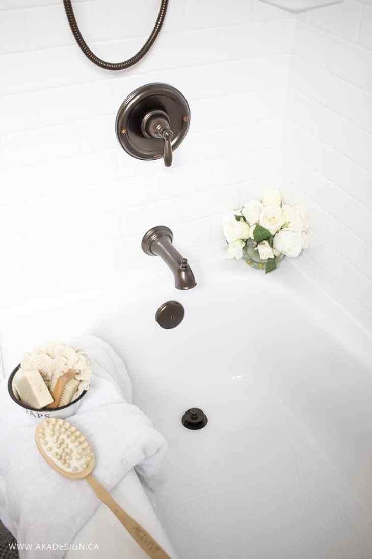 White tub, oil rubbed bronze fixtures, farmhouse accents