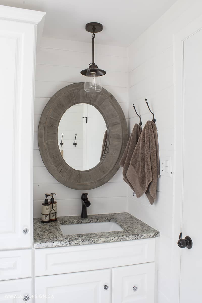 bathroom vanity and oval mirror