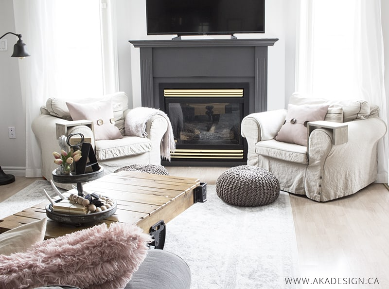 farmhouse living room ektorp chairs and grey fireplace