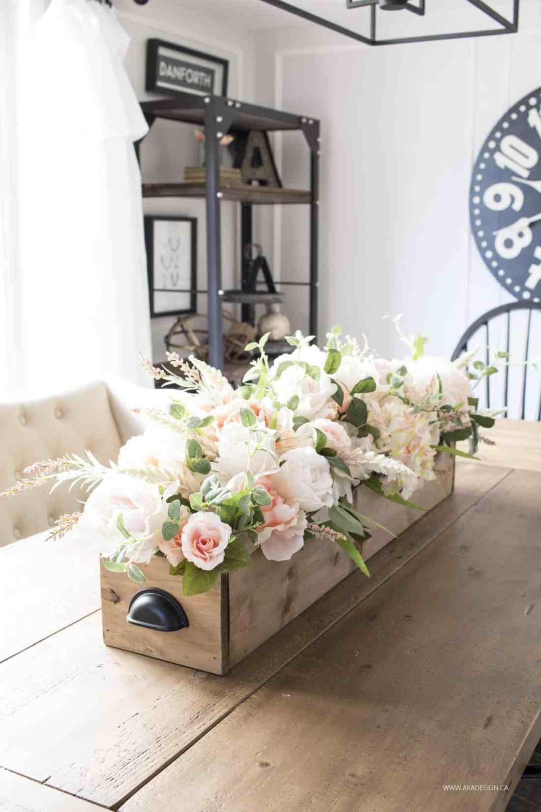 faux florals in crate centerpiece