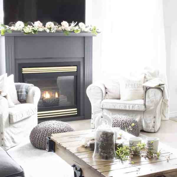 faux flowers and real on fireplace mantel