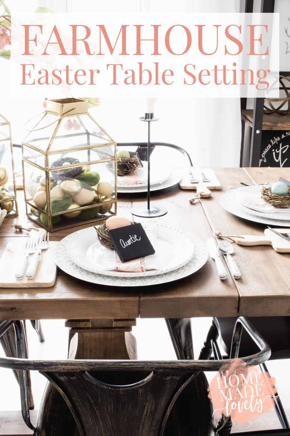 spring and Easter table setting, white dishes, gold and glass lanterns, pink ribbon