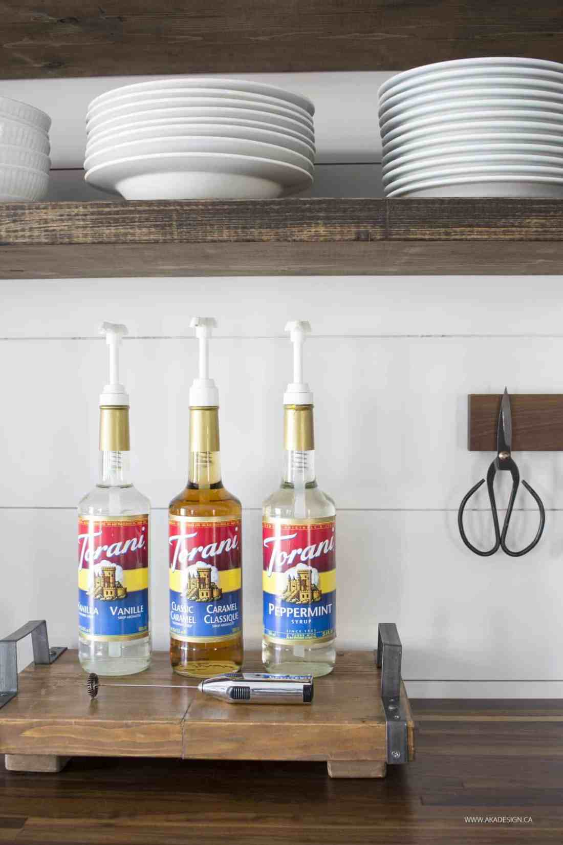 torani coffee syrups on a tray in farmhouse kitchen