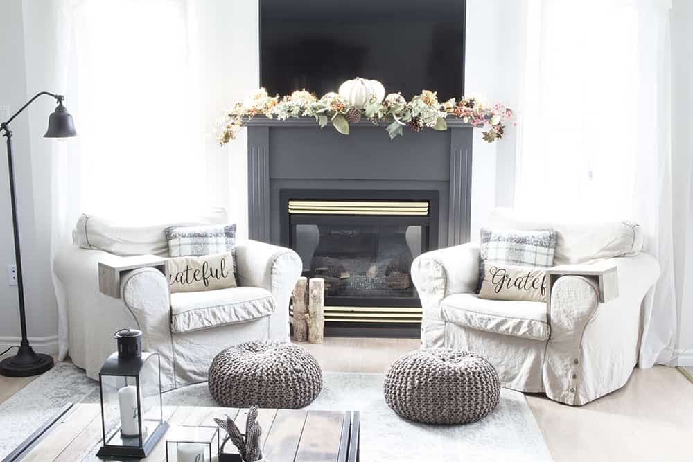 fireplace with two armchairs flanking