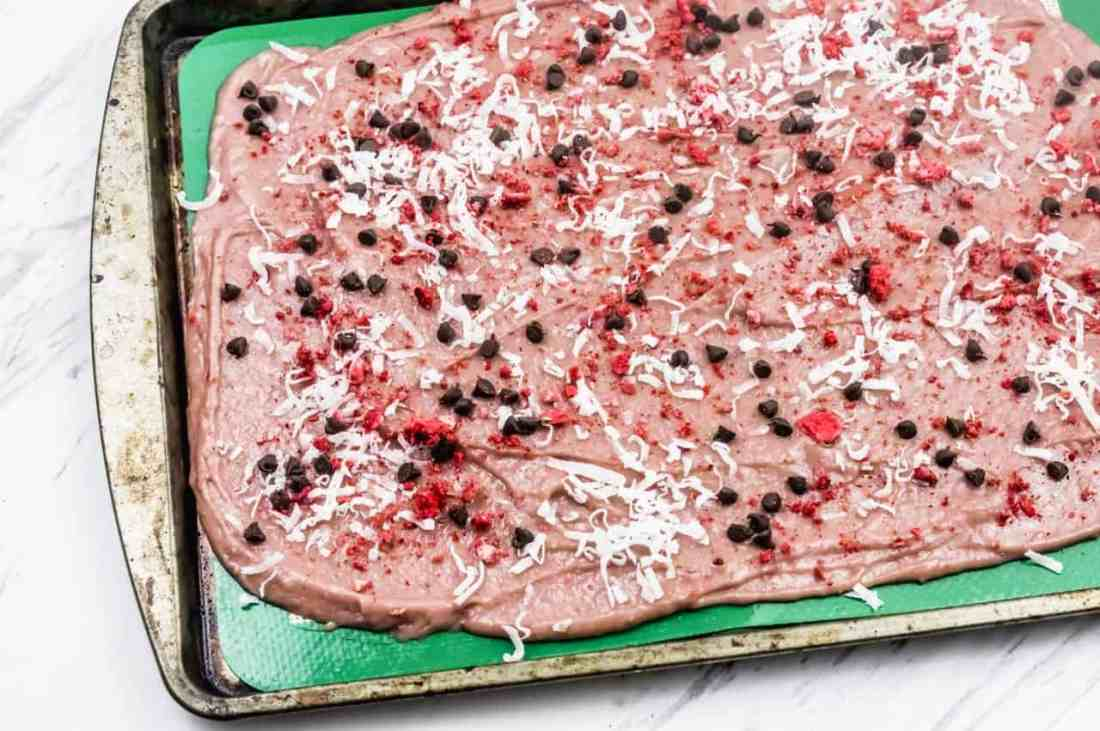 Strawberry bark ingredients on cookie sheet