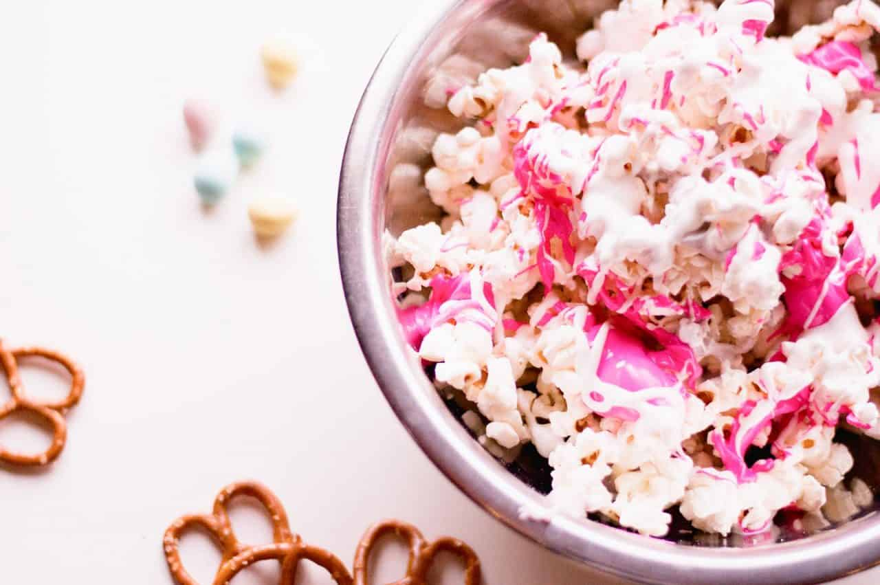 popcorn in a stainless steel bowl with colorful candy