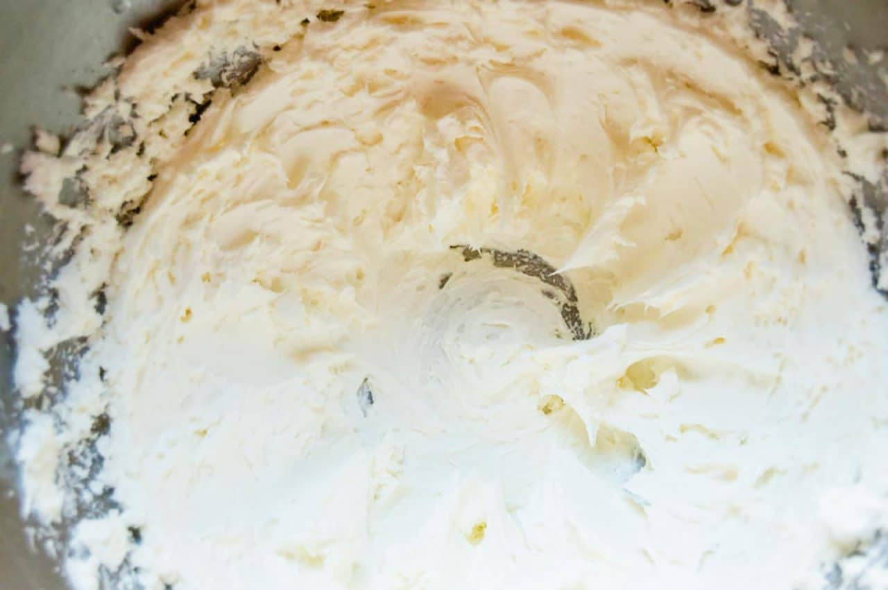 Whip cream cheese in mixer