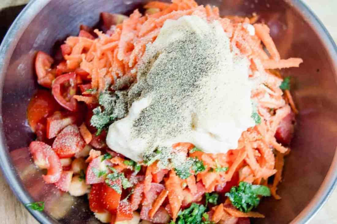 adding spices to veggies