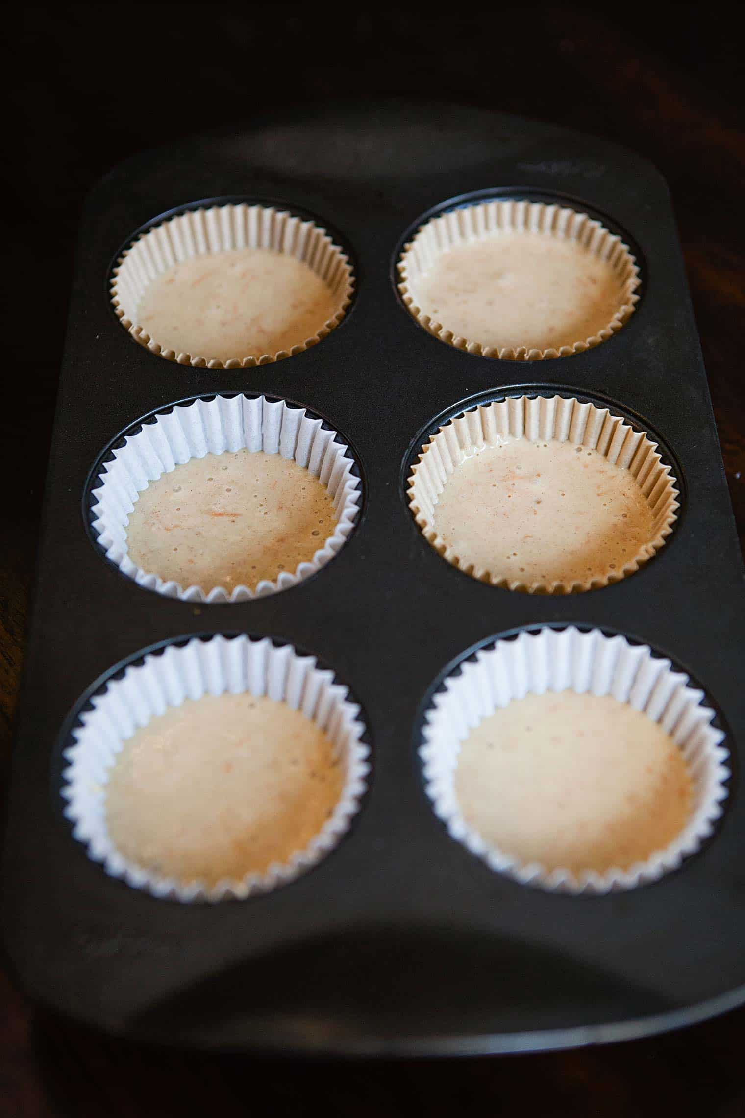 carrot-cupcake-batter-in-muffin-tins-ready-to-bake