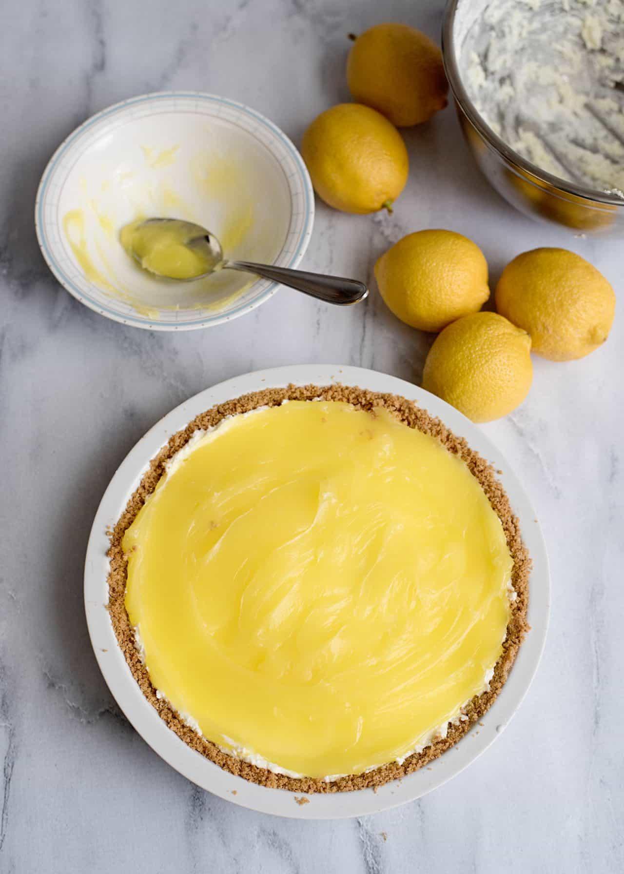 lemon cream pie filling in graham cracker crust ready to chill