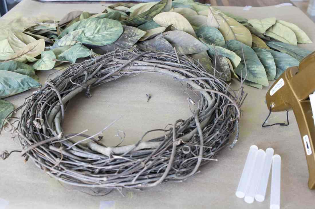 ready to glue leaves on diy magnolia wreath