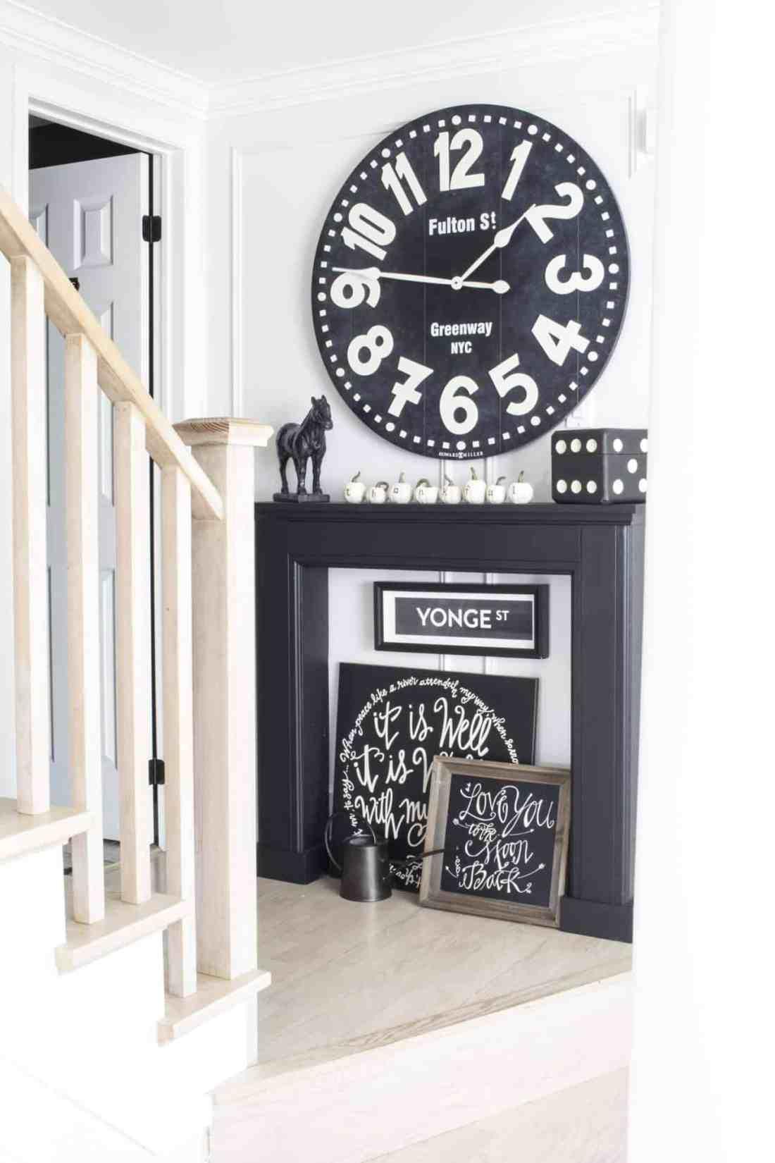 huge black wall clock black mantel
