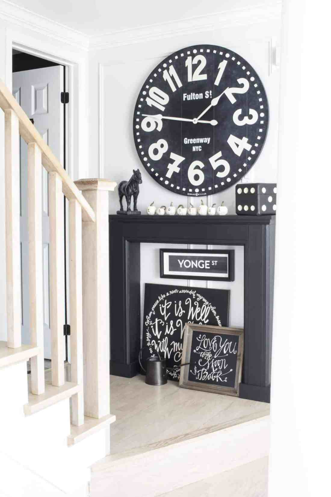 huge black wall clock black mantel