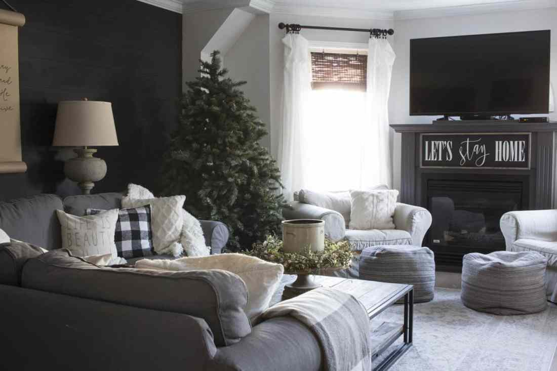 modern farmhouse living room with christmas tree