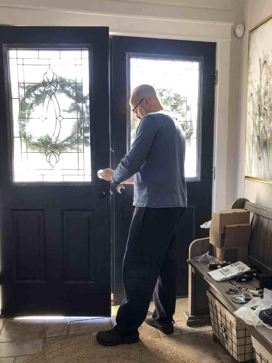 Dean installing front door locks