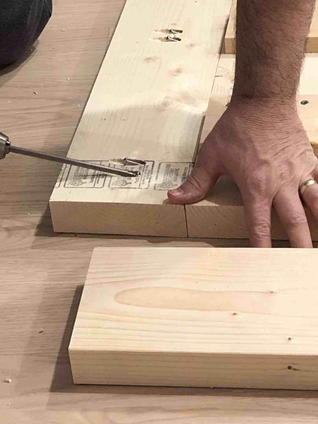 man screwing screws into pocket holes