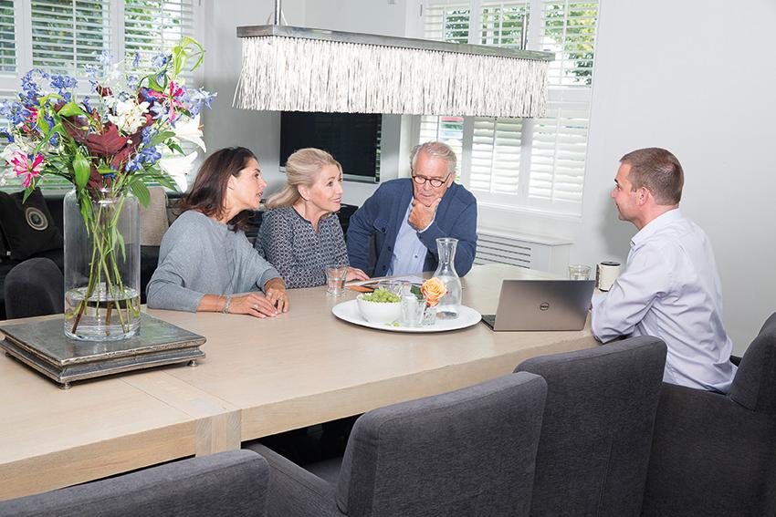 people, sitting around table deciding