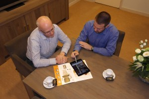 Handicare consultant discussing with client. brochure