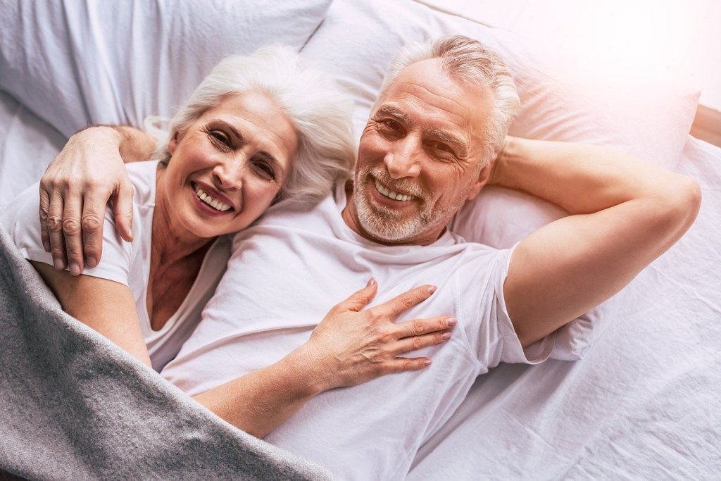 senior couple, couple in bed, couple holding