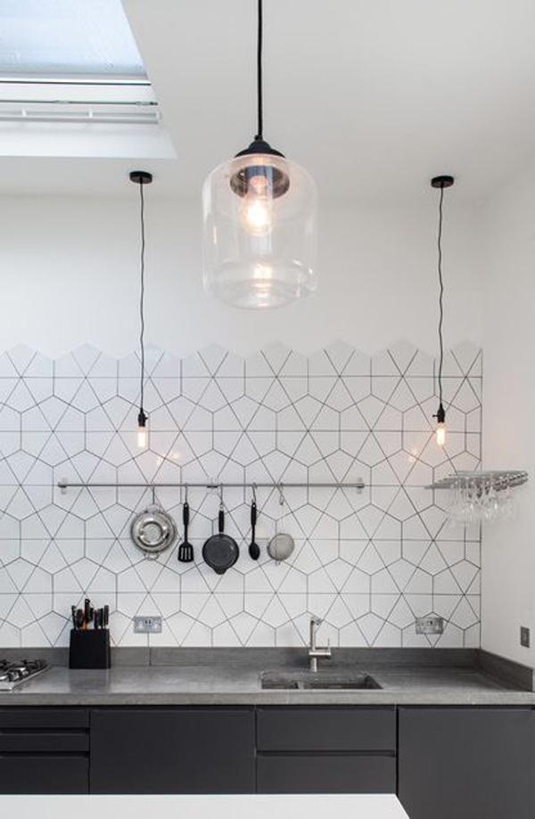 black hexagon tile kitchen backsplash