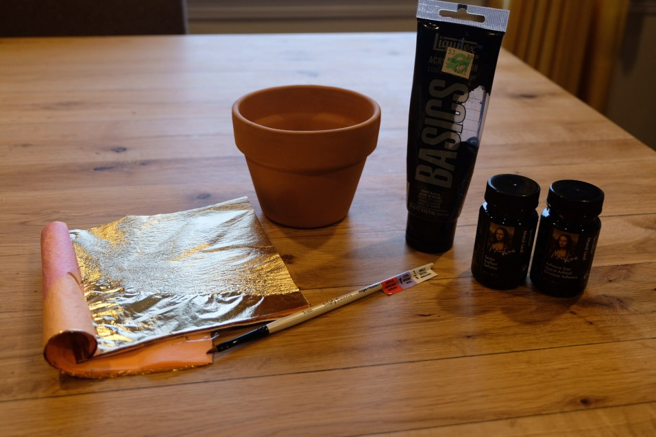 Everything that you need: 1. a pot 2. black paint 3. paint brush 4. Speedball metal foil adhesive and seal 4. metal foil