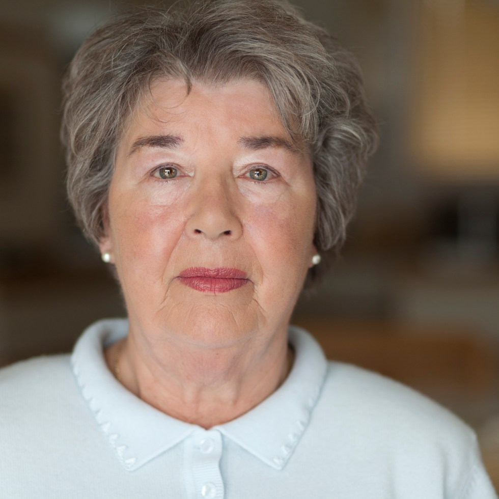 Portrait Of A Senior Woman Looking At The Camera
