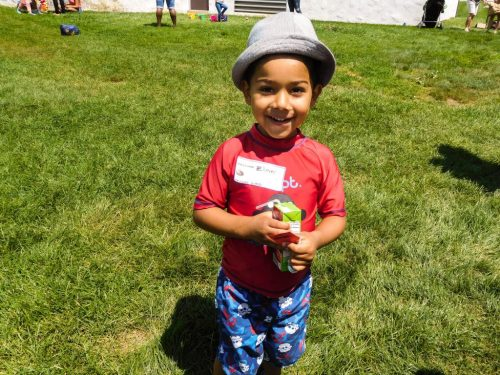 Boy with hat smiling at summer BBQ