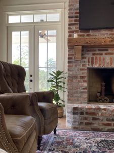Fiddle leaf fig tree, houseplant, brick fireplace, french doors
