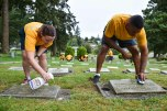 160816-N-OO032-068 BREMERTON, Wash. (Aug. 16, 2016) – Chief Logistics Specialist (Select) Jennifer Cunningham, from Bloomington, Illinois, and stationed with Naval Supply Systems Command Fleet Logistics Center Puget Sound, and Chief Master-at-Arms (Select) Andre Billingsley, from Trenton, New Jersey, clean headstones with fellow Pacific Northwest chief petty officer selects during a community relations event at Ivy Green Cemetery as part of the USS Turner Joy (DD 951) Legacy Academy. The academy entails living aboard the Vietnam-era destroyer while participating in community relation projects, ship preservation, leadership training, and a naval heritage capstone project. The Turner Joy is one of four naval memorial in the U.S. to host legacy academies, the other three being the Iowa-class battleship USS Missouri (BB 63), USS Midway (CVB/CVA/CV 41) and USS Constitution, a wooden hulled, three-masted heavy frigate and oldest commissioned warship in the world. (U.S. Navy photo by Mass Communication Specialist 1st Class Cory Asato/Released)