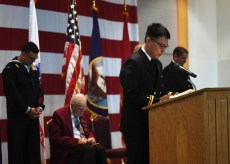 EVERETT, Wash. (Nov. 9, 2016) Lt. Jg. Richard Min, Naval Station Everett command chaplain, performs the invocation during the annual Naval Station Everett Veterans Day ceremony in the Grand Vista Ballroom. The event honors veterans, past and present, who served in the United States Armed Forces. (U.S. Navy photo by Petty Officer 3rd Class Joseph Montemarano/Released)